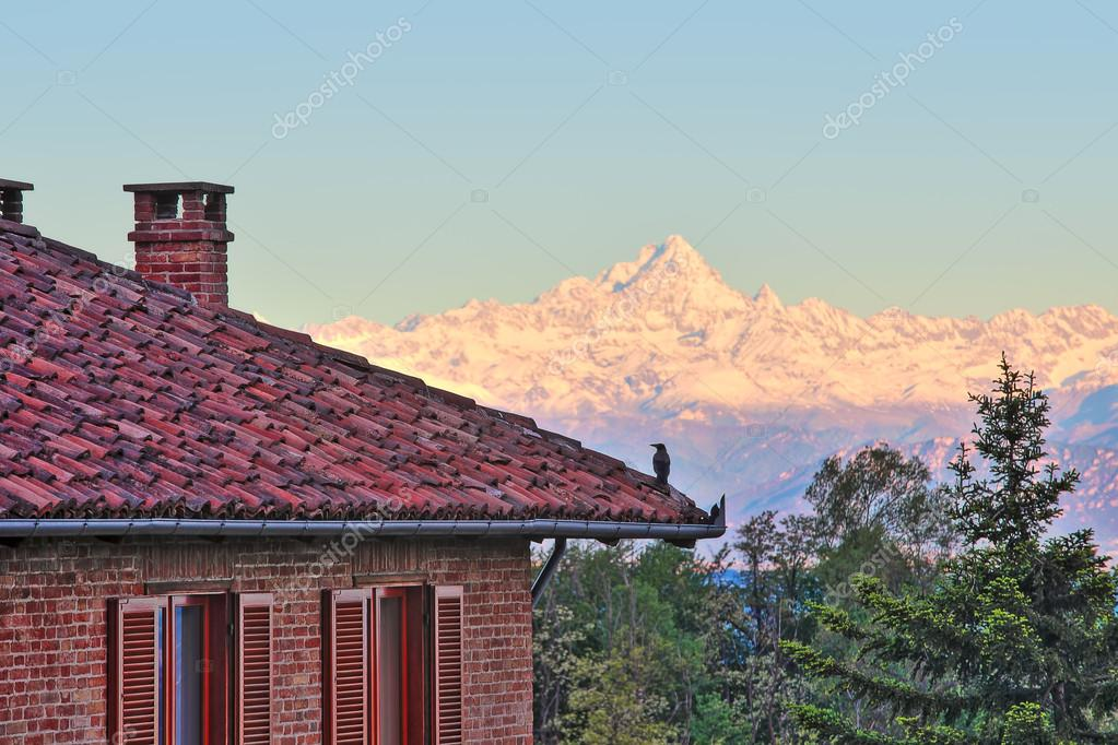 Red Brick House With Tiled Roof And Snowy Peaks Of Monviso Mountain (part  Of Italian Alps) On Background In Piedmont, Northern Italy. U2014 Photo By  Rglinsky