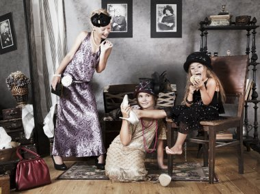 Little girls with retro fashion accessories
