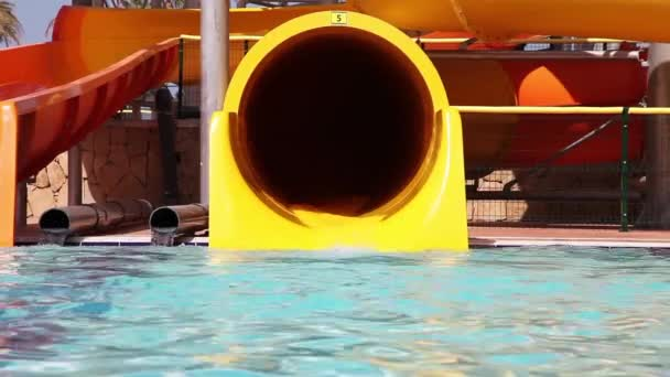 Senior Have Fun On Water Slide