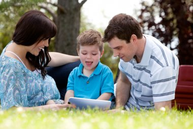 Family in Park with Digital Tablet