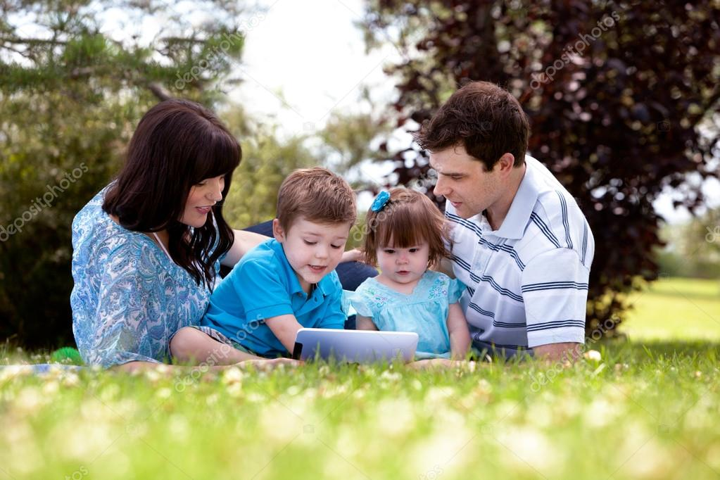 Outdoor Family with Digital Tablet