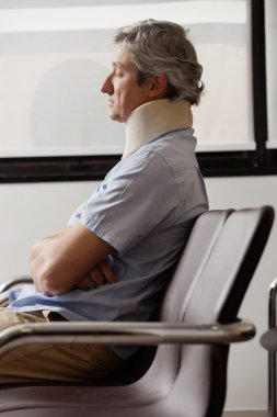 Man With Neck Injury Resting In Lobby