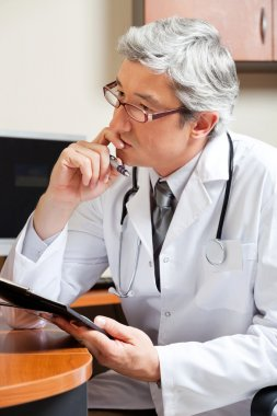 Thoughtful Doctor At Desk