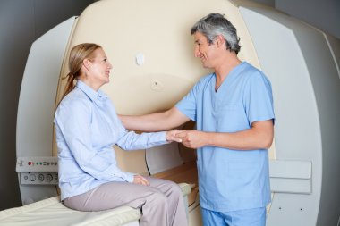 Radiologic Technician With Patient