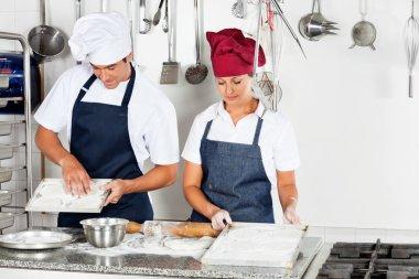 Chefs Baking At Kitchen Counter