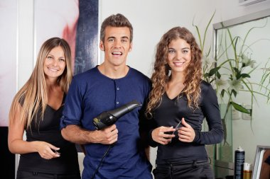 Happy Hairstyling Team At Beauty Parlor