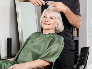Woman Having Hair Cut At Salon