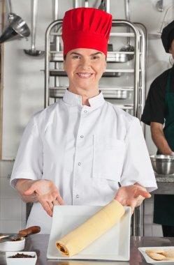 Female Chef Presenting Chocolate Roll