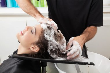Client Getting Hair Washed By Hairstylist