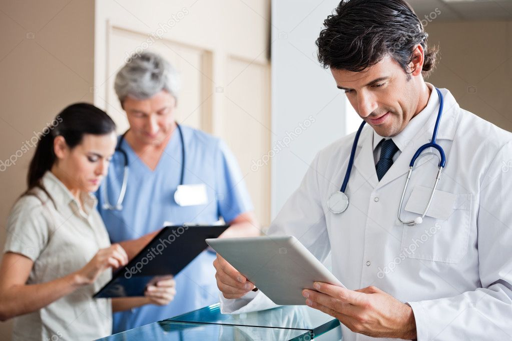 Male Doctor Holding Digital Tablet