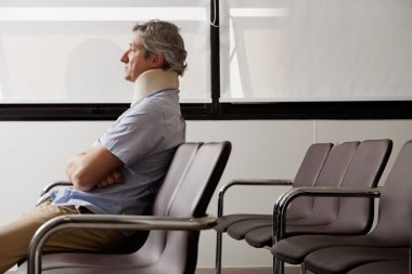Man With Neck Injury Waiting In Lobby
