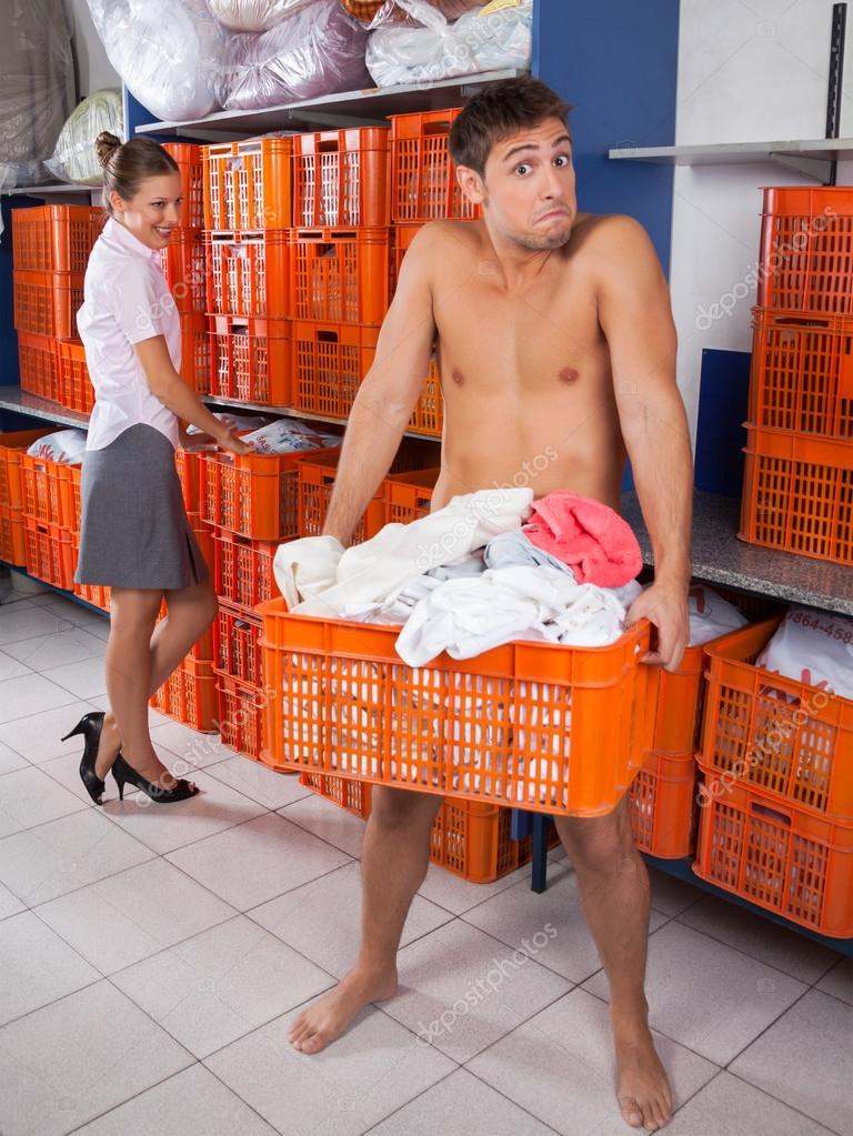 Man Holding Clothes basket With Businesswoman Looking At Him
