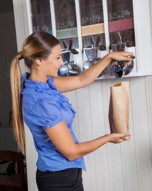 Female Customer Buying Coffee From Vending Machine