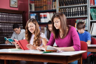Teenage Students Studying In Library