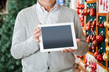 Man Holding Digital Tablet At Christmas Store
