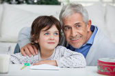 Boy And Grandfather With Envelope Smiling