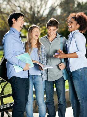 Happy Students Standing In Campus