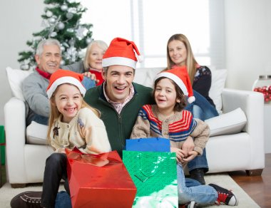 Happy Family With Gifts During Christmas