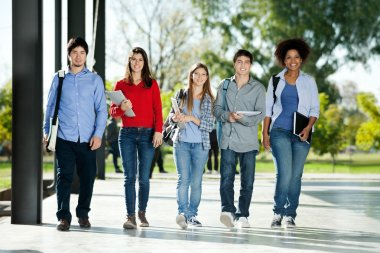 Confident Students Walking In A Row On Campus