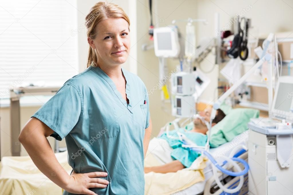 Confident Nurse With Patient Resting In Background