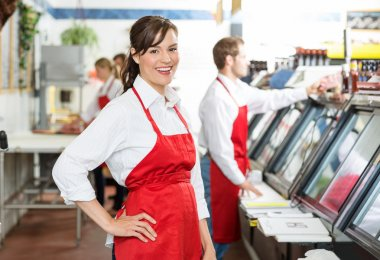 Confident Butcher Standing At Store
