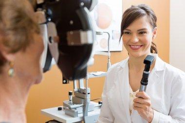Optometrist Examining Senior Woman's Eyes
