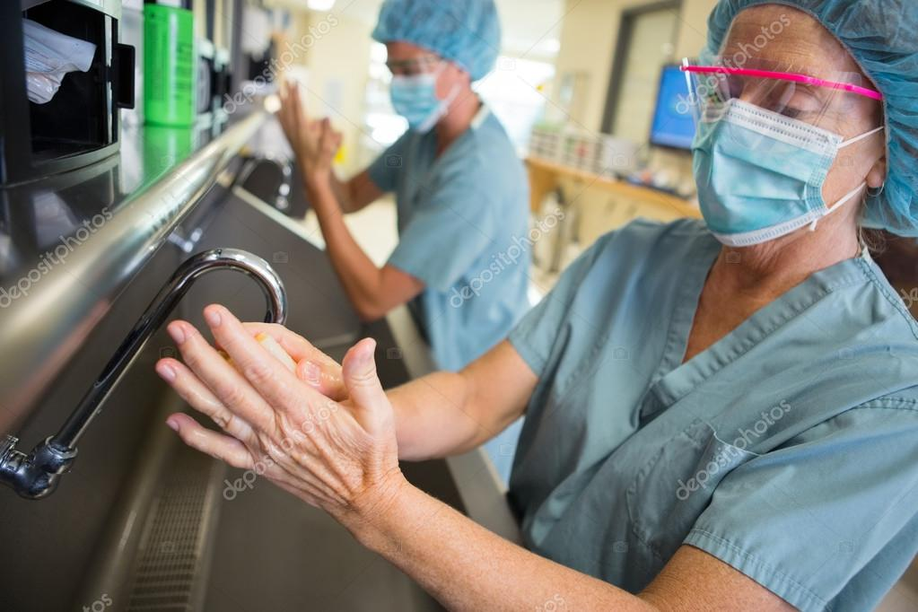 Female Surgeon Scrubbing Hands and Arms