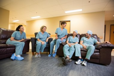 Medical Team Conversing In Hospital's Waiting Room