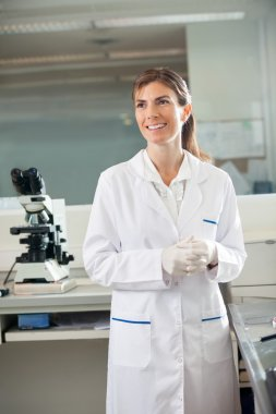 Scientist Standing In Medical Laboratory
