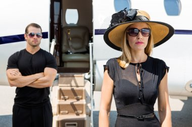 Beautiful Woman With Bodyguard Against Private Jet