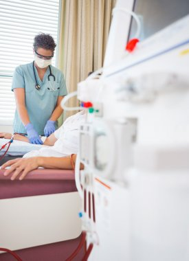 Nurse Giving Renal Dialysis Treatment To Patient