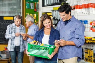 Happy Couple Buying Tools At Hardware Store