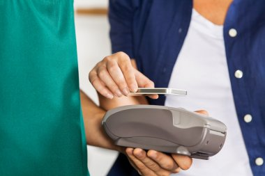 Customer Paying With Smartphone Using NFC