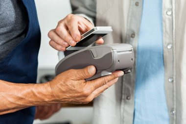 Salesman Accepting Payment Through NFC Technology