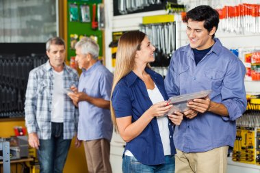 Couple Buying Tool Set In Hardware Store