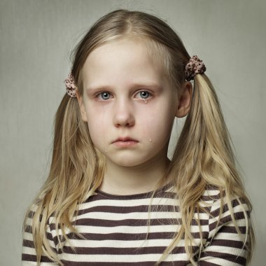 Child with tears - young girl crying