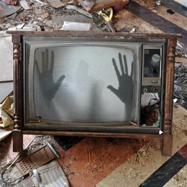Ghost appears on flickering tv set