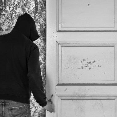 Man exiting through door