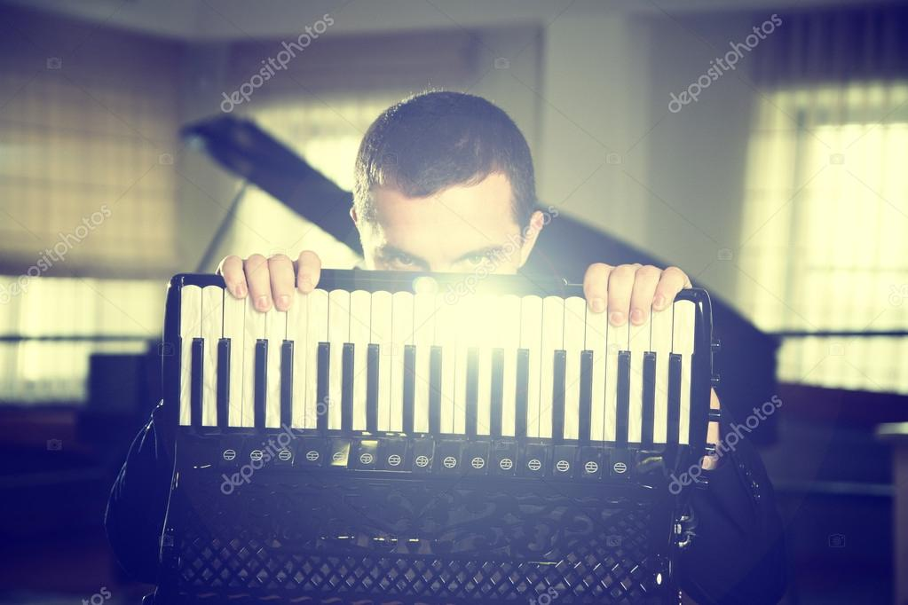 a man with an accordion