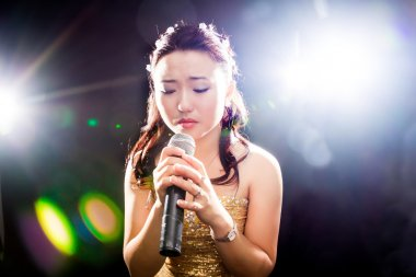 Singing woman of Asia