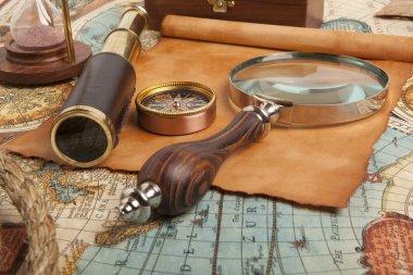 Brass telescope on map
