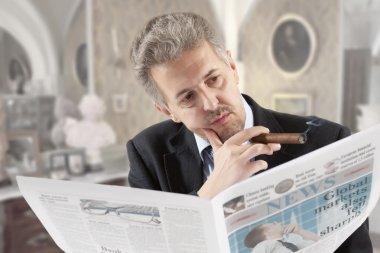 Businessman reading a newspape