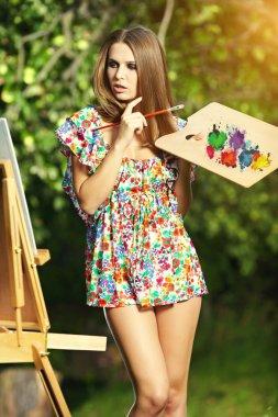 Woman artist paints nature stock vector