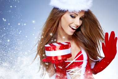 beautiful sexy girl wearing santa claus clothes with christmas
