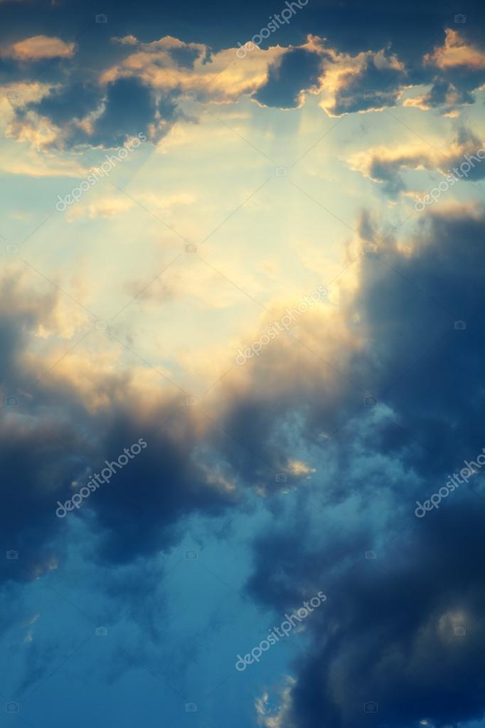 Cumulus clouds on sunset sky background