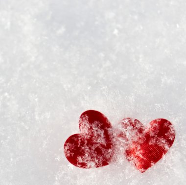 Two red frozen heart on snow stock vector