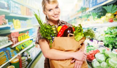 Woman shopping for fruits and vegetables in produce department of a grocery store, supermarket stock vector