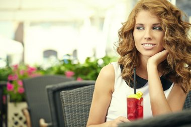 Charming woman in a restaurant