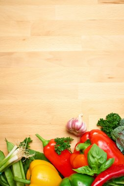 Healthy Organic Vegetables on a Wooden Background. Art Border De