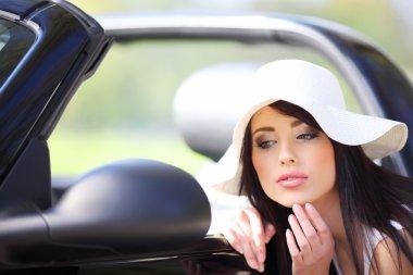 Fashion woman and cabrio car